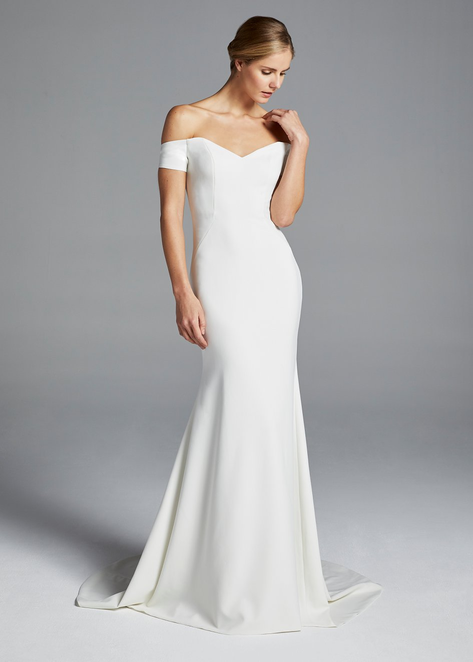 Anne Barge S Jolie Gown Features A Portrait Neckline Of Spanish Stretch Crepe With Open Back And Cuff Sleeves Finished Bow Band