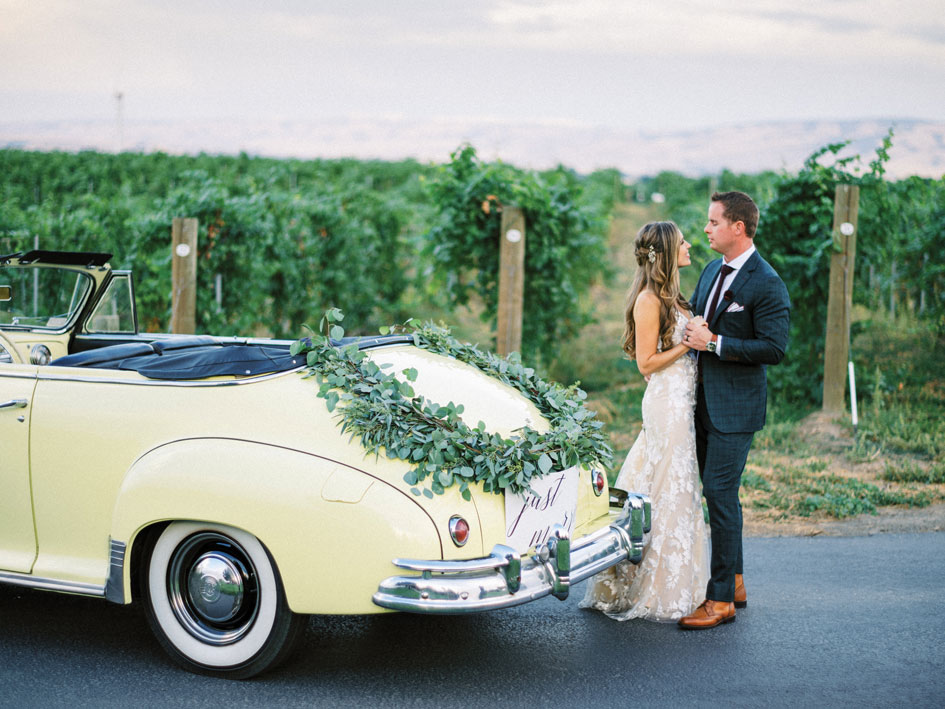 Afton and Liam at Basel Cellars with their vintage convertible getaway car.