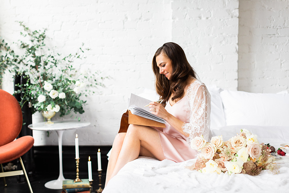 Bride relaxing and journaling before her wedding ceremony.