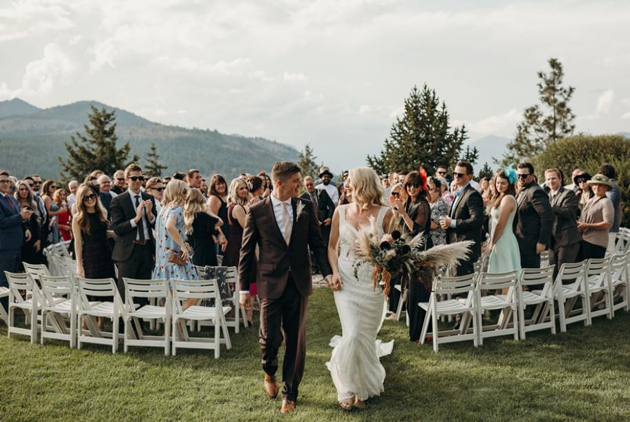 In the round ceremony with mountains in the background at Sun Mountain Lodge